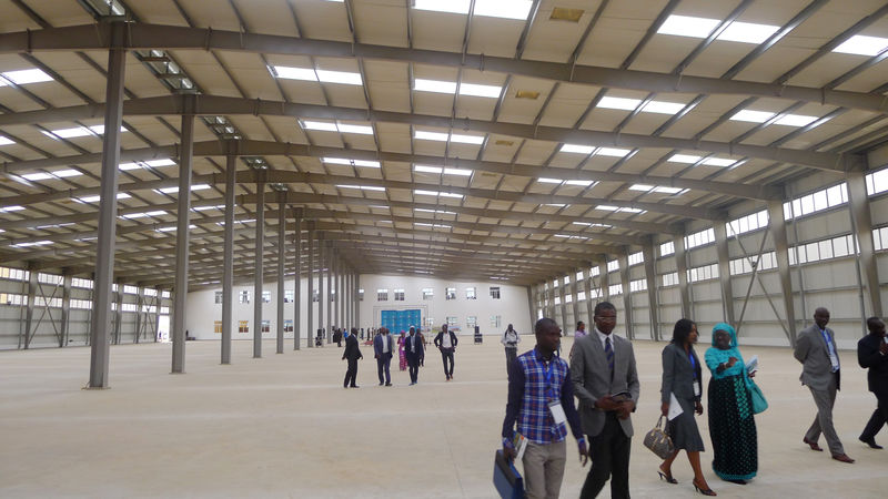 Visitors and business people tour a factory building on a U.N. organised trip to Senegal's new Diamniadio industrial park in Senegal