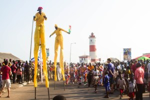 Stilt-walkers-and-the-lighthouse-Photo-by-Selorm-Jay