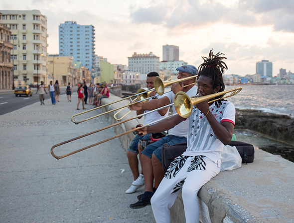Musicians plan on Havana's old stone wall of the Malecón.