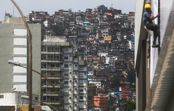 apartment-buildings-stand-next-to-houses-in-the-rocinha-favela-community-rio-de-janeiro-mario-tama-65973