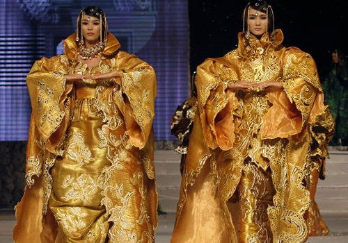 Exotic gold wedding dresses by Andr Kim