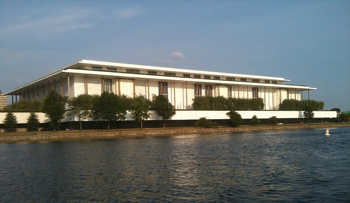 1200px-Kennedy_Center_seen_from_the_Potomac_River,_June_2010.jpg