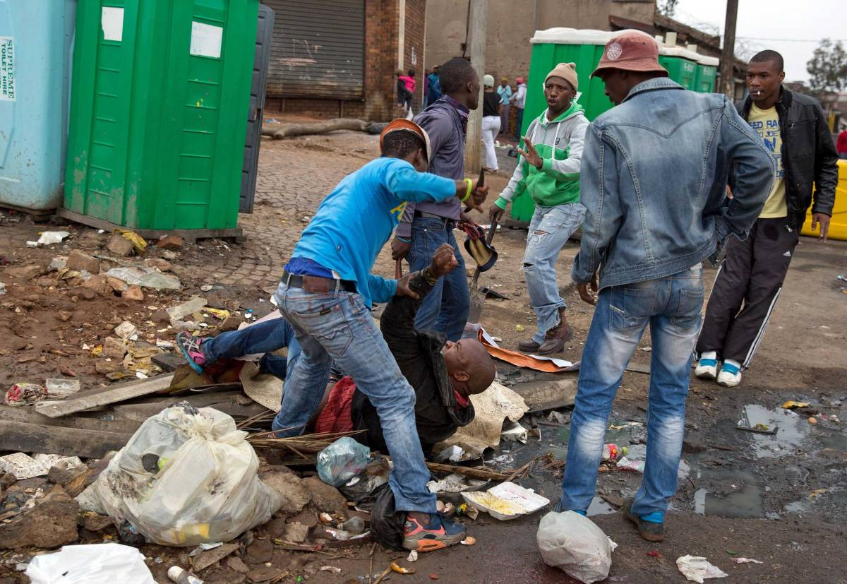 Mozambique national Emmanuel Sithole is attacked by men in Alexandra township during the anti-immigrant violence  in Johannesburg